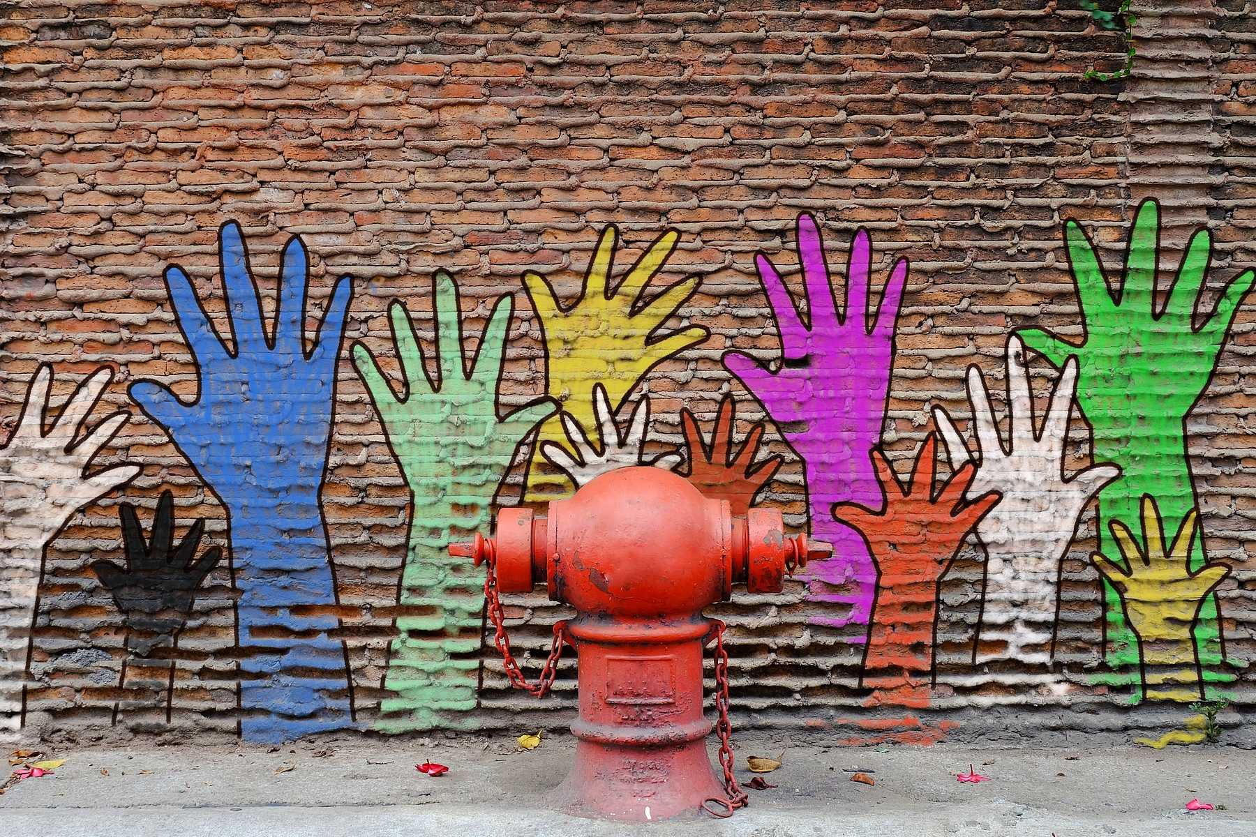 Wall with multicolored hands