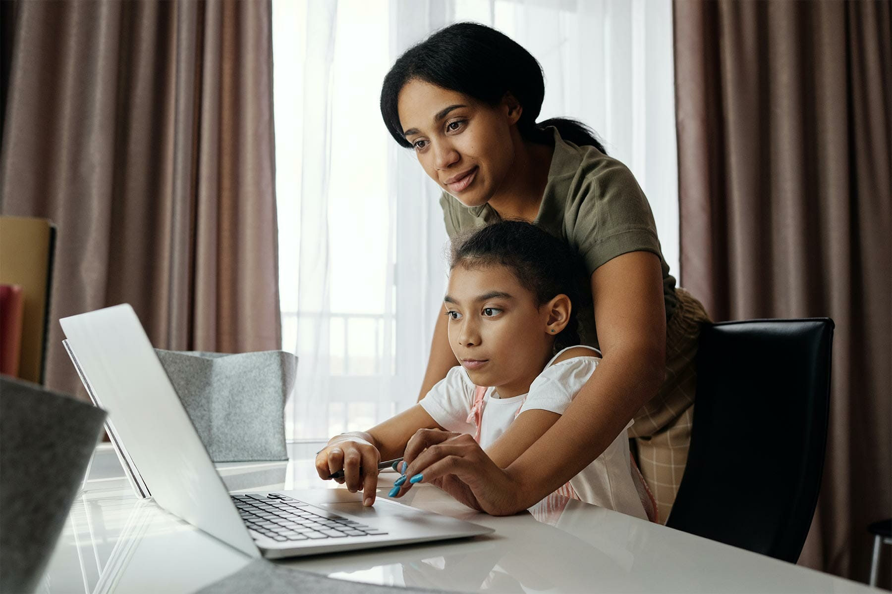 Mom and daughter working on the laptop